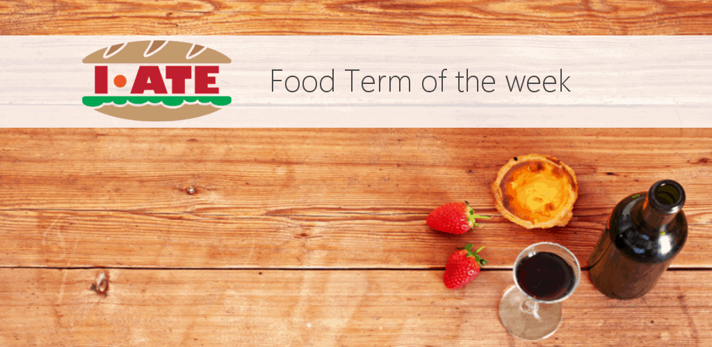 I-ATE Food Term of the Week banner - Porto wine, pasteis de nata and strawberry over wooden table