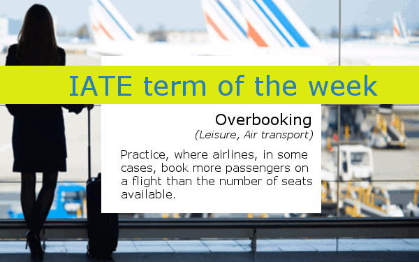 IATE defintion of overbooking - Woman with luggage at an airport staring at aeroplanes